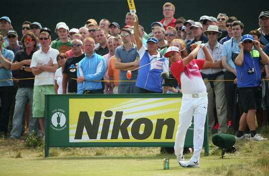HOYLAKE, ENGLAND - JULY 18:  Rickie Fowler of the United States hits his tee shot on the seventh hole during the second round of The 143rd Open Championship at Royal Liverpool on July 18, 2014 in Hoylake, England. Photo: Mike Ehrmann, Getty Images / 2014 Getty Images