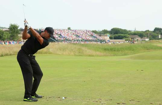 HOYLAKE, ENGLAND - JULY 18:  Tiger Woods of the United States hits his tee shot on the ninth hole during the second round of The 143rd Open Championship at Royal Liverpool on July 18, 2014 in Hoylake, England. Photo: Andrew Redington, Getty Images / 2014 Getty Images