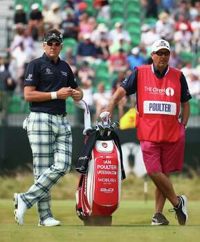 HOYLAKE, ENGLAND - JULY 18:  Ian Poulter of England waits on the fourth tee with his caddie Terry Mundy during the second round of The 143rd Open Championship at Royal Liverpool on July 18, 2014 in Hoylake, England. Photo: Matthew Lewis, Getty Images / 2014 Getty Images