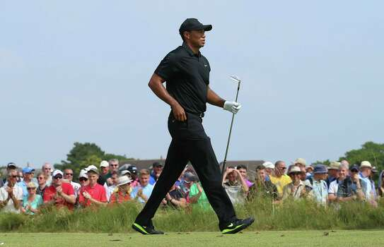 HOYLAKE, ENGLAND - JULY 18:  Tiger Woods of the United States walks off a tee box during the second round of The 143rd Open Championship at Royal Liverpool on July 18, 2014 in Hoylake, England. Photo: Andrew Redington, Getty Images / 2014 Getty Images