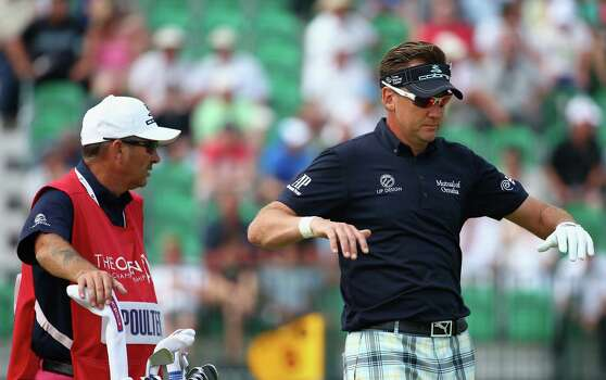 HOYLAKE, ENGLAND - JULY 18:  Ian Poulter of England stretches on the fourth tee with his caddie Terry Mundy during the second round of The 143rd Open Championship at Royal Liverpool on July 18, 2014 in Hoylake, England. Photo: Matthew Lewis, Getty Images / 2014 Getty Images