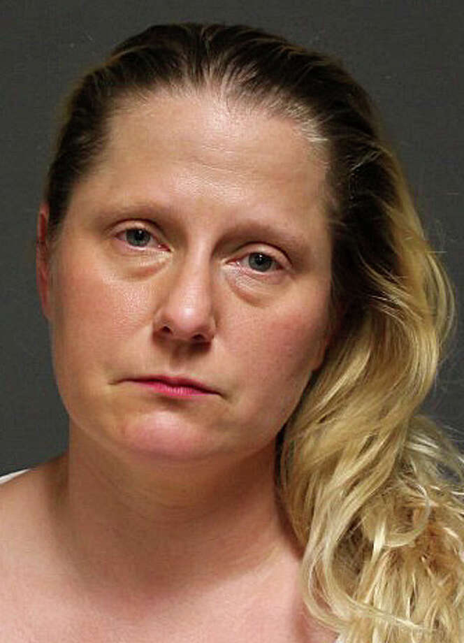 Sadie Lynne Ouellette, 36, of Las Vegas, Nev., faces a series of charges after police said she stole a wallet from a Trader Joe's customer, and used stolen credit cards to illegally withdraw funds from a bank and tried to use them to purchase two Rolex watches at Lenox Jewelers. Photo: Fairfield Police Department / Fairfield Citizen