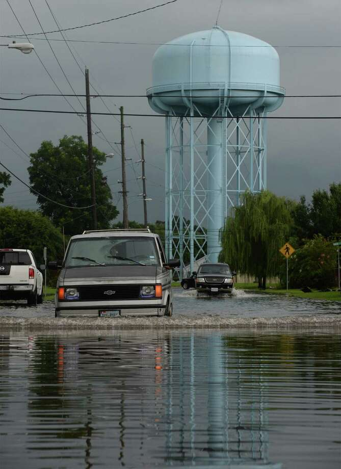 Flooding near Sabine Pass Avenue. Photo taken Friday, July 18, 2014 Guiseppe Barranco/@spotnewsshooter Photo: Guiseppe Barranco, Photo Editor