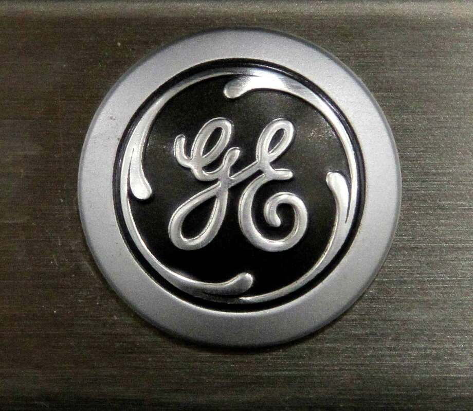 A General Electric logo is seen on a kitchen stove at a Lowe's store in Framingham, Mass. Photo: Steven Senne, Associated Press / Associated Press