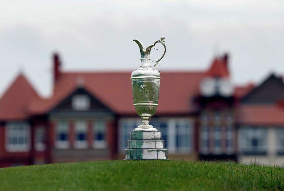 "The British Open Golf trophy, better known as the ""Claret Jug,"" is displayed  by the clubhouse at the Royal Liverpool Golf Club in Hoylake, England. The British Open golf championship wrapped up its second round on Friday. (AP Photo/Jon Super, File) Photo: Jon Super, STR / AP"