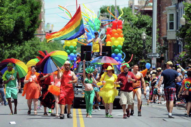 Albany is the 7th most gay-friendly city in America. Los Angeles is number one and Madison, Wisconsin is number ten.  Lark Street during the Capital Pride Parade on Saturday, June 14, 2014, in Albany, N.Y. Photo: Cindy Schultz, . / 00027244A