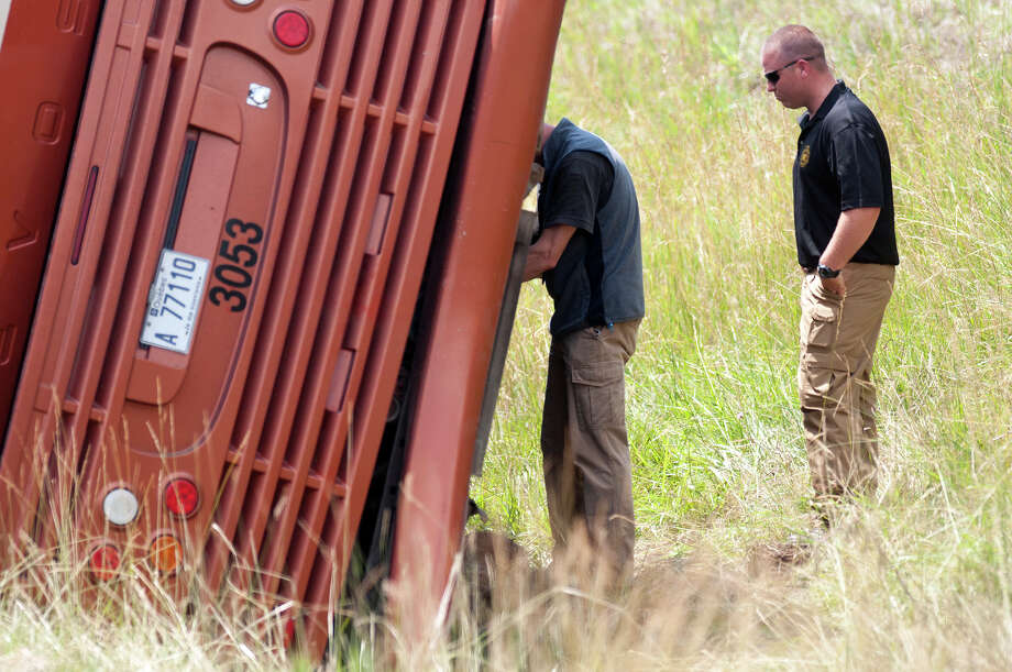 Emergency personnel investigate the scene of fatal bus crash near exit 29 of the Northway in the southbound lanes Friday morning, July 18, 2014, in North Hudson, N.Y. One person was killed and 55 injured. The bus was traveling from Quebec to New York City. (Tom Brenner/ Special to the Times Union) Photo: Tom Brenner / ©Tom Brenner/ Albany Times Union