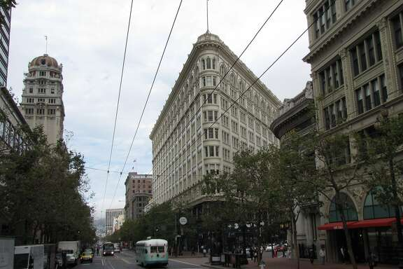 "The Phelan Building at 760 Market is one of San Francisco's most distinctive ""flatirons"" -- buildings designed to fill the triangular lots created by the collision of straight and diagonal streets, in this case Market and O'Farrell. It opened in 1908; the architect was William Curlett."