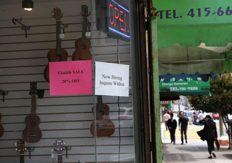 A now hiring sign is posted in the window of a music store in San Francisco. Photo: Justin Sullivan, Getty Images