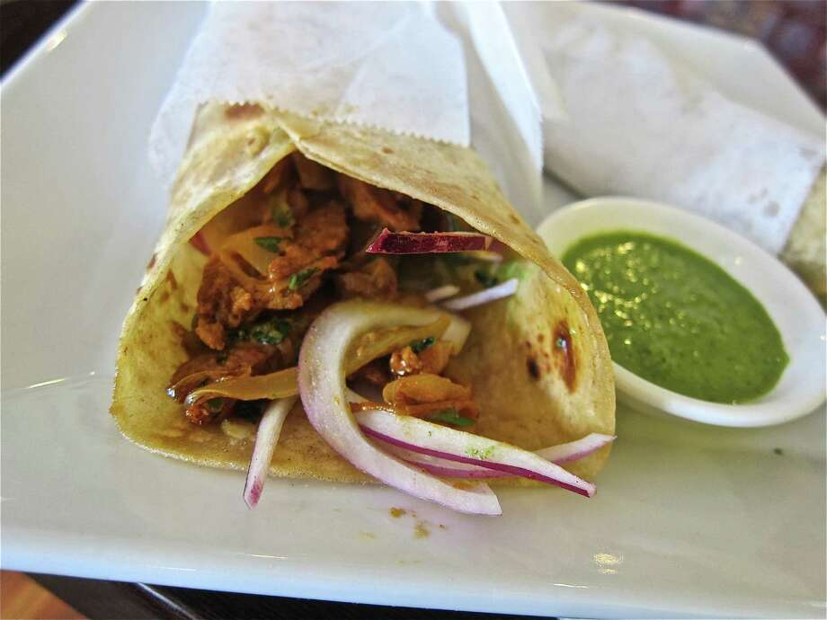 An Awadhi lamb kati roll from the lunch menu of Great W'Kana Cafe in Meadows Place. Photo: Alison Cook