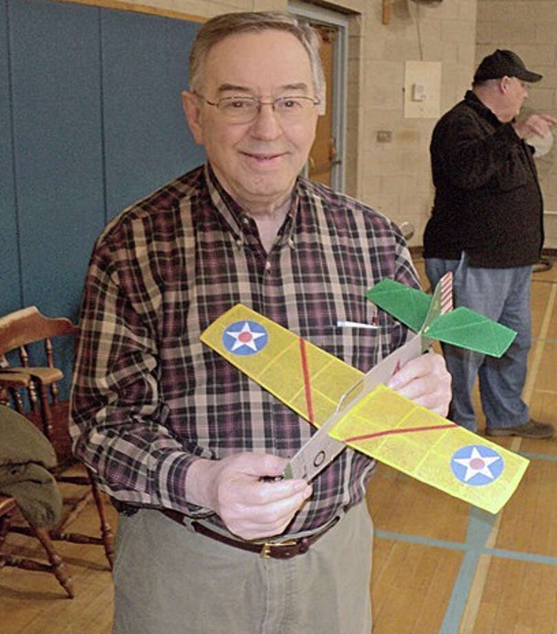 Dr. Richard DeAngelis, the leader of the Fairfield Flying Aces and a retired history professor, prepares to fly his plane at the Fairfield Senior Center. Aviation enthusiasts meet each Wednesday afternoon to propel their miniature aircraft around the gym. Photo: Contributed Photo / Fairfield Citizen