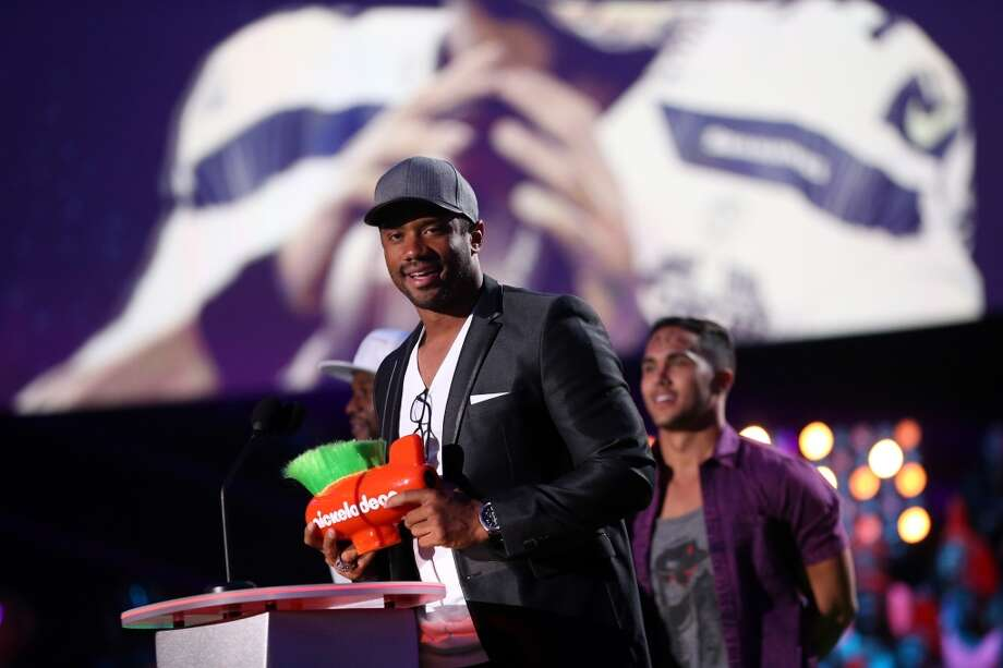 NFL player Russell Wilson accepts the Best Newcomer Award onstage during Nickelodeon Kids' Choice Sports Awards 2014 at UCLA's Pauley Pavilion on July 17, 2014, in Los Angeles. Photo: Mark Davis, Getty Images