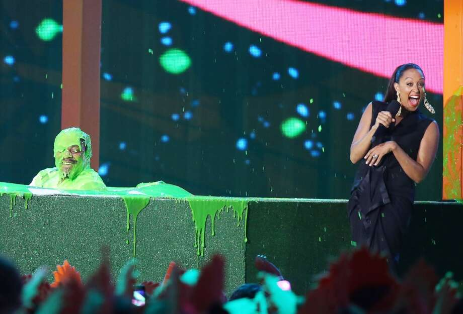 Marshawn Lynch (L) and Tia Mowry-Hardrict speak onstage during the Nickelodeon Kids' Choice Sports Awards 2014 held at Pauley Pavilion on July 17, 2014, in Los Angeles. Photo: Michael Tran, FilmMagic