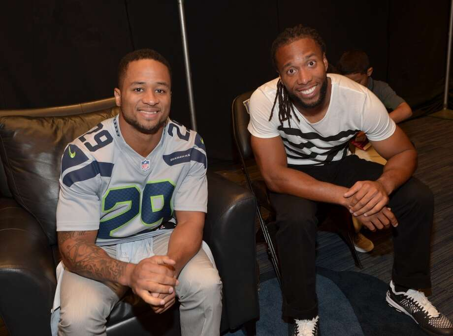 Earl Thomas (L) and Larry Fitzgerald attend Nickelodeon Kids' Choice Sports Awards 2014 at UCLA's Pauley Pavilion on July 17, 2014, in Los Angeles. Photo: Charley Gallay/KCSports2014, Getty Images