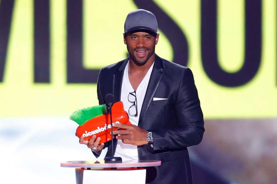 Russell Wilson speaks onstage on stage at Nickelodeon Kids' Choice Sports Awards 2014 at Pauley Pavilion on July 17, 2014, in Los Angeles. Photo: Joe Scarnici, WireImage
