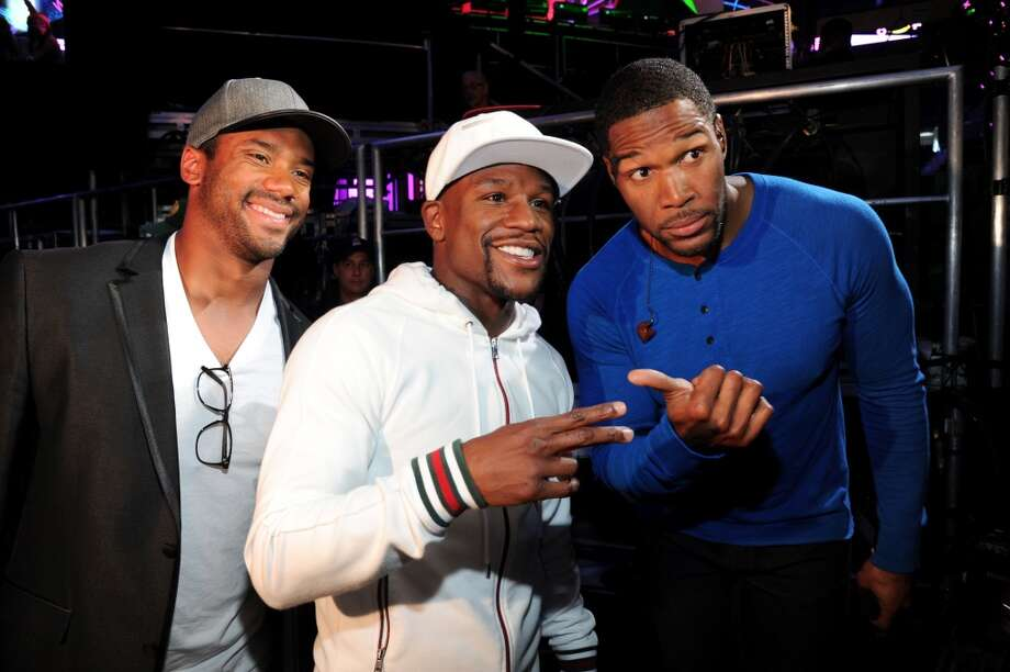 Russell Wilson, professional boxer Floyd Mayweather and host Michael Strahan backstage during the Nickelodeon Kids' Choice Sports Awards 2014 at UCLA's Pauley Pavilion on July 17, 2014, in Los Angeles. Photo: Kevin Mazur/KCSports2014, WireImage