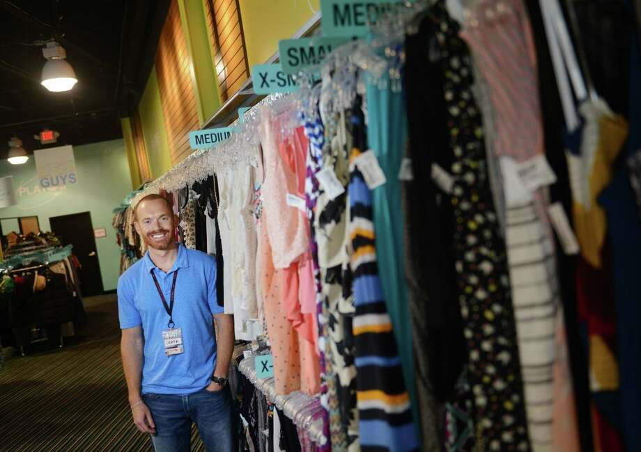 Owner Derek Bell poses at Plato's Closet in Danbury, Conn. Thursday, July 17, 2014.  The used clothing store located in the Berkshire Shopping Center is currently buying used clothes in preparation for the store's Aug. 17 grand opening. Photo: Tyler Sizemore / The News-Times