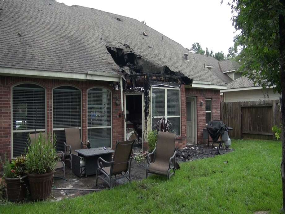 Fire ripped through this Woodlands home after it was struck by lightning yesterday.  The Westwind Circle home was one of five that were struck but it was the only one to catch.  The whole Robinson family are safe including their two schnauzers. Photo: Scott Engle/Montgomery County Police Reporter