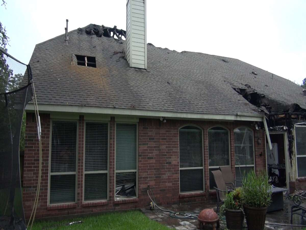 Fire ripped through this Woodlands home after it was struck by lightning yesterday. The Westwind Circle home was one of five that were struck but it was the only one to catch. The whole Robinson family are safe including their two schnauzers.