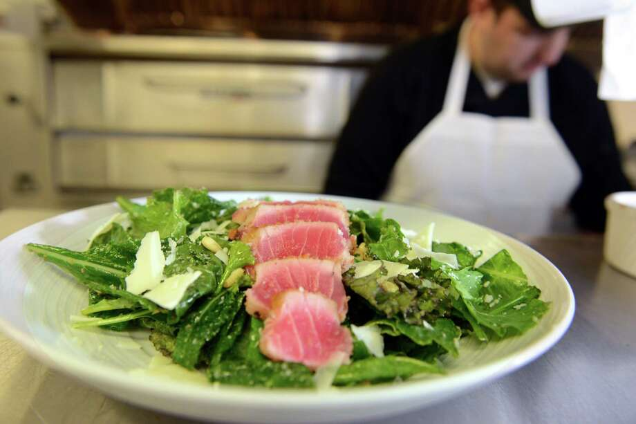 Baby kale with pan seared tuna, pine nuts and pecorino romano with a zesty lemon vinaigrette at the Spinning Wheel restaurant in Redding, Conn. Photo: Autumn Driscoll / Connecticut Post
