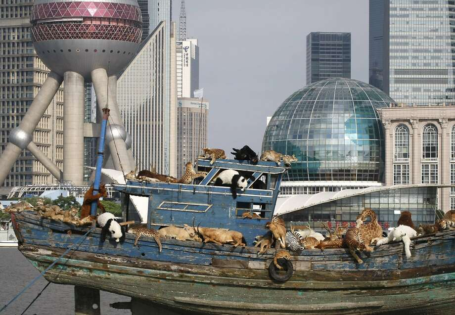 "Mutiny on the Ark:Stuffed animals overrun a vessel floating down the Huangpu River in Shanghai in the installation ""The Ninth Wave"" by Chinese artist Cai Guoqiang. The artwork, consisting of an old fishing boat laden with plushy animals, was inspired by last year's incident in which 16,000 dead pigs were found floating down the Huangpu. Photo: ChinaFotoPress, Getty Images"