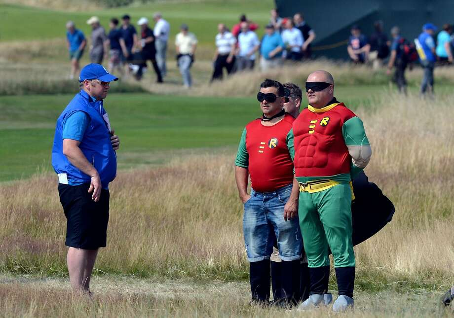Multiple Boys Wonder:A bachelor's party of several Robins accompanying a Batman groom (not shown) watch the action at the British Open in Hoylake, England. Photo: Paul Ellis, AFP/Getty Images