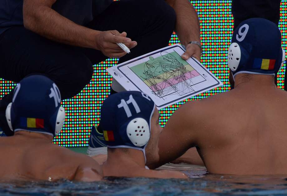 Everybody got it? Romanian coach Dejan Stanojevic diagrams a play that would take an advanced physics degree to figure out during the Water Polo European Championships match against Montenegro in Budapest. Photo: Attila Kisbenedek, AFP/Getty Images
