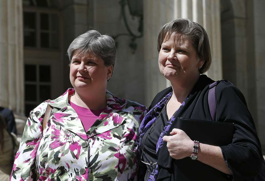 In the April 17, 2014, photo plaintiffs challenging Oklahoma's gay marriage ban Sharon Baldwin, left, and her partner Mary Bishop leave court following a hearing at the 10th U.S. Circuit Court of Appeals in Denver, Thursday, April 17, 2014. The three-judge panel of the 10th U.S. Circuit Court of Appeals in Denver on Friday, July 18, 2014, found a ban on same-sex marriage in Oklahoma violates the U.S. Constitution. In a Utah case, the court ruled June 25 that gay couples have a constitutional right to wed. (AP Photo/Brennan Linsley, File) Photo: Brennan Linsley, Associated Press