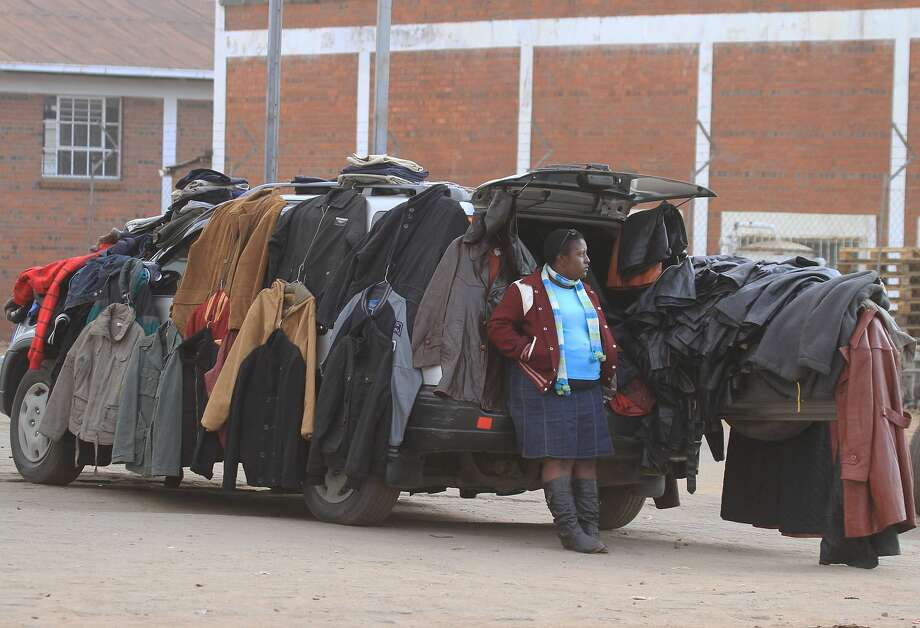 Open for business: A clothes peddler offers fashions out of her SUV in Harare, where unemployment exceeds 70 percent. Photo: Tsvangirayi Mukwazhi, Associated Press