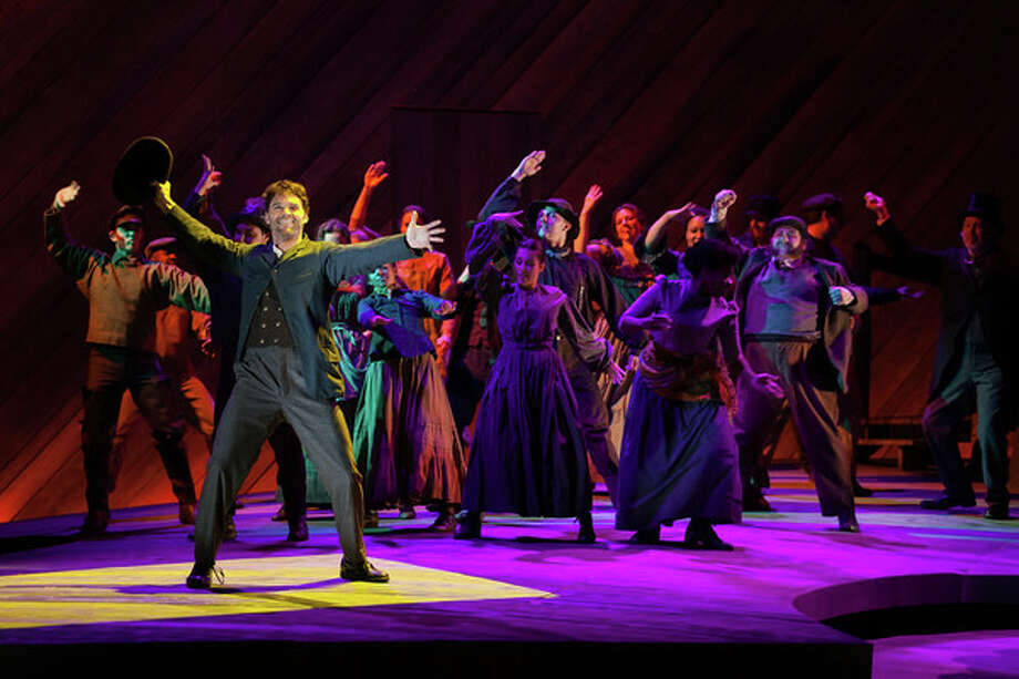"""Ryan McKinny as Billy Bigelow and the ensemble in The Glimmerglass Festival's 2014 production of Rodgers and Hammerstein's """"Carousel."""" Photo: Karli Cadel/The Glimmerglass Festival. Photo: """"Karli Cadel"""" / """"© 2014 Karli Cadel"""""""