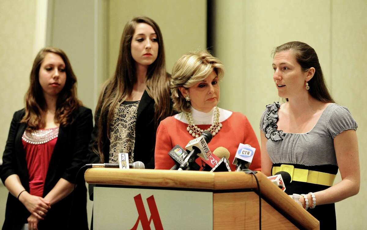 Kylie Angell, right, speaks to the media as attorney Gloria Allred, second from right, Erica Daniels, left, and Carolyn Luby, second from left, listen, during a news conference, Wednesday, Jan. 10, 2007, in Hartford, Conn. The University of Connecticut will pay nearly $1.3 million to settle a federal lawsuit filed by five women who claimed the school responded to their sexual assault complaints with indifference, the two sides announced Friday.