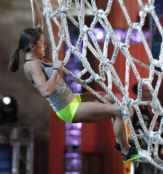 "Kacy Catanzaro meets one of the challenges of ""American Ninja Warrior."" Photo: Getty Images / 2014 NBCUniversal Media, LLC"