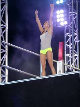 "Kacy Catanzaro celebrates her accomplishment on ""American Ninja Warrior."" She lives and trains in San Antonio. Photo: NBC / 2014 NBCUniversal Media, LLC"