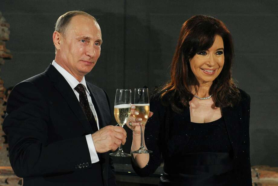 Russian President Vladimir Putin toasts Argentina's President Cristina Fernandez in Buenos Aires. Putin and Chinese President Xi Jinping are expanding commercial ties in the region. Photo: Mikhail Klimentyev, Associated Press