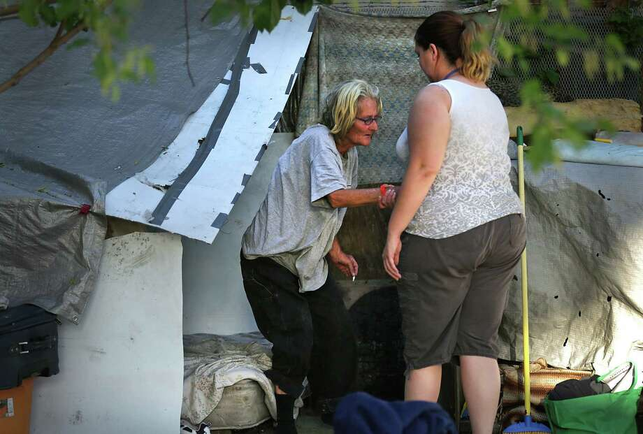 Through words and pictures — such as this one of Asten Jones helping her mother, Sandy Snell, weak after completing detox — we see the richness of lives that we otherwise would dismiss. Photo: Bob Owen / San Antonio Express-News / © 2012 San Antonio Express-News