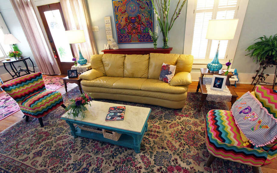 Furniture, fabric and art provide bursts of color in the living room of the home Jennifer Gonzalez and Frank Garcia rehabbed in Monte Vista. Photo: Photos By Danny Warner / For The Express-News / ALL RIGHTS RESERVED UNLESS OTHERWISE SPECIFIED
