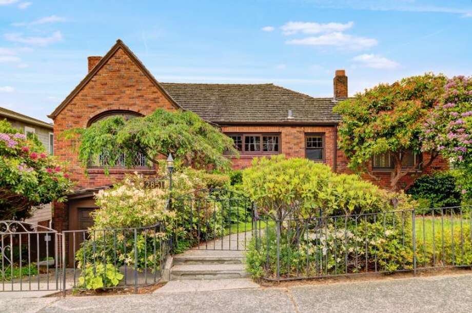 We'll start with the oldest home on our tour, 2851 43rd Ave. W., which was built in 1931 and is on the market for the first time in 70 years, according to the listing. The 3,430-square-foot brick Tudor has three bedrooms, 2.5 bathrooms, mahogany millwork, leaded and stained glass, coved ceilings, a deck, and sound and mountain views on an 8,050-square-foot lot. It's listed for $950,000. Photo: Courtesy Monte Johnson And Jim Dickinson/Windermere Real Estate