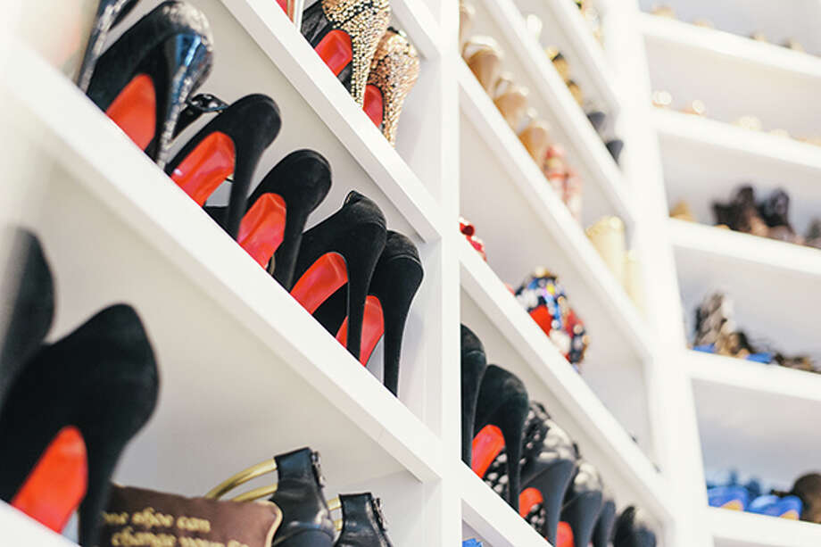 Hundreds upon hundreds of pairs of shoes adorn the walls of the closet's second floor which also has a champagne bar and a salon. Photo: Chinh Phan, Chinh Phan/Neiman Marcus / Fotowerk Group
