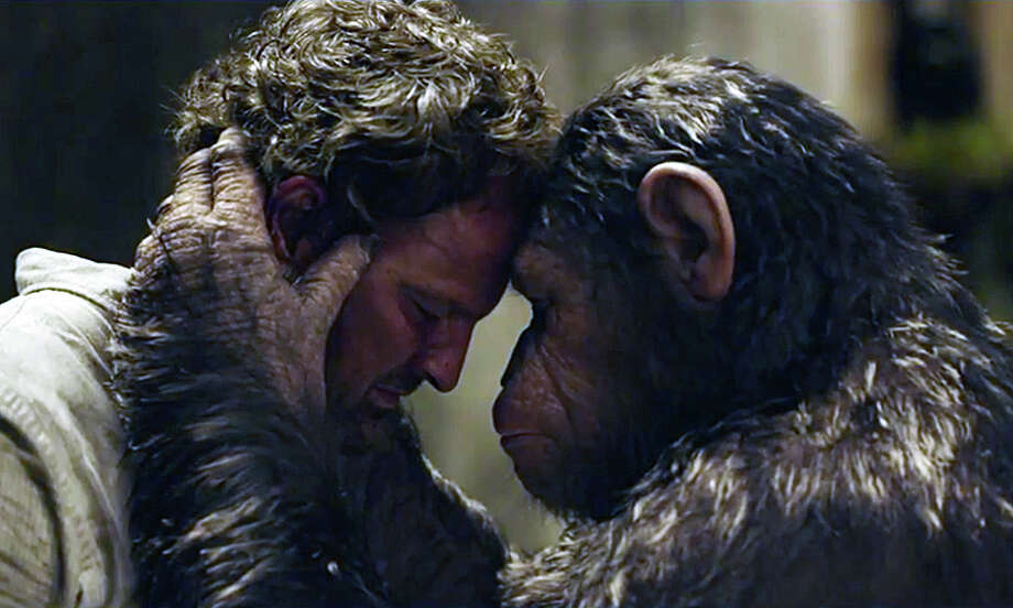"""Human-simian interaction in the new movie, """"Dawn of the Planet of the Apes."""" Our film critic, Susan Granger, offers her review. Photo: Contributed Photo / Fairfield Citizen"""