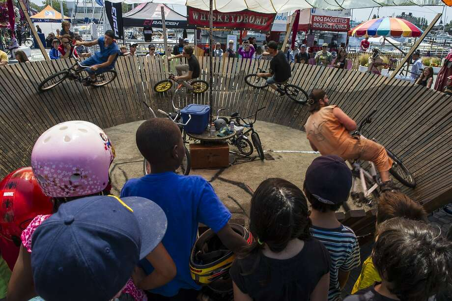 Riders circle the banked wooden Whiskeydrome at Pedalfest, an annual cycling celebration in Jack London Square. Photo: Darrell Sano 2013