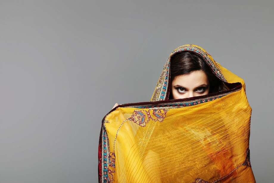 "Nadia Parvez Manzoor brings her autobiographical one-woman show ""Burq Off!"" to the Bay Area, playing several characters in the comic story of one woman's look at sex, religion, culture, identity and family, growing up in a glum British Pakistani home. Photo: Courtesy Of The Artist"