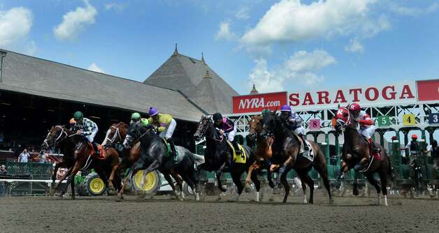 Horses break the gate for the first race of the 2014 Saratoga Race Course meeting Friday afternoon July 18, 2014 in Saratoga Springs, N.Y.    (Skip Dickstein / Times Union) Photo: SKIP DICKSTEIN, ALBANY TIMES UNION