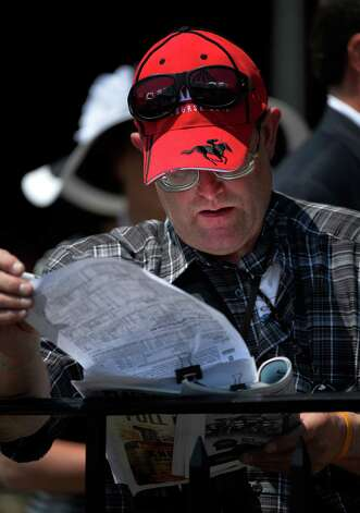Handicapper DaleTillotson of Burlington Vt. attends his 22nd consecutive opening day at the Saratoga Race meeting Friday afternoon July 18, 2014 in Saratoga Springs, N.Y.    (Skip Dickstein / Times Union) Photo: SKIP DICKSTEIN, ALBANY TIMES UNION