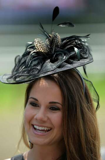Brittany Jasenski shows off her black fascinator on opening day of the 2014 Saratoga Race Course mee