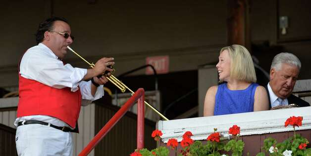 Sammy the Bugler entertains Mary Ann Jennings wife of former Albany Mayor Jerry Jennings, right on opening day  of the 2014 Saratoga Race Course meeting Friday afternoon July 18, 2014 in Saratoga Springs, N.Y.    (Skip Dickstein / Times Union) Photo: SKIP DICKSTEIN, ALBANY TIMES UNION