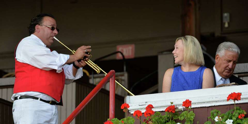 Sammy the Bugler entertains Mary Ann Jennings wife of former Albany Mayor Jerry Jennings, right on o