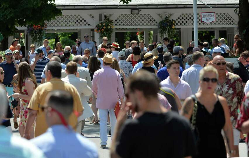 A large crowd attended the opening day of the 2014 Saratoga Race Course meeting Friday afternoon Jul