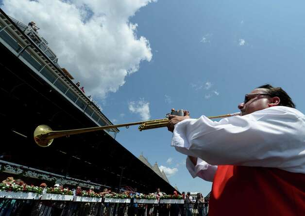 "Sammy ""The Bugler"" Grossman plays the call to the post on opening day of the 2014 Saratoga Race Course meeting Friday afternoon July 18, 2014 in Saratoga Springs, N.Y.    (Skip Dickstein / Times Union) Photo: SKIP DICKSTEIN, ALBANY TIMES UNION"
