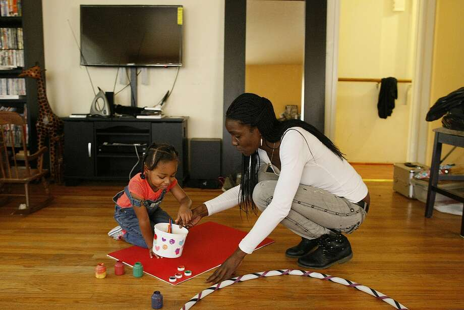 Charla Williams, who works at an S.F. treatment center, plays with daughter Omara Dumetz at her Vallejo home. Photo: James Tensuan, The Chronicle