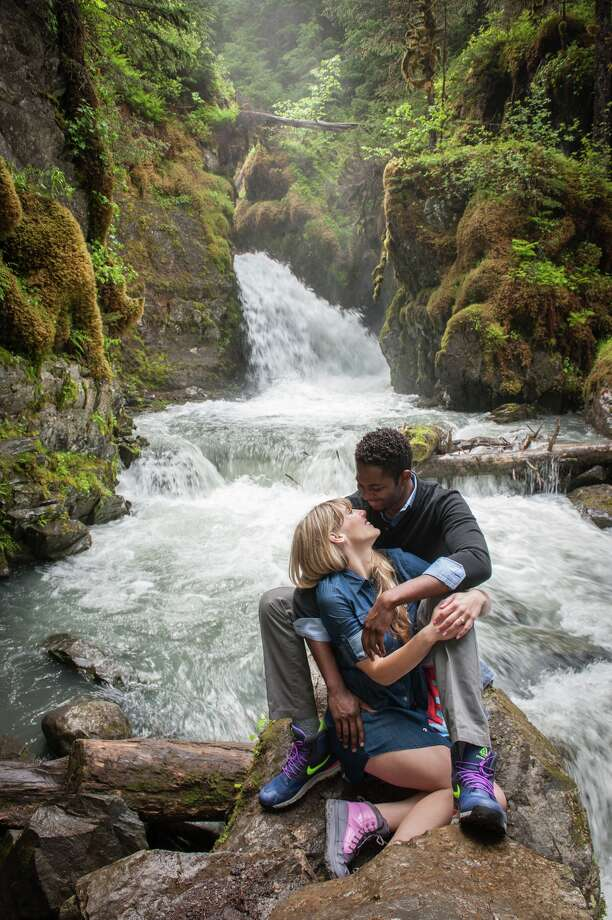 Chad Moore and Abby Wilkinson re-enact their engagement, this time on camera, in front of Virgin Creek Falls in Alaska. Photo: Daryl Pederson / Daryl Pederson